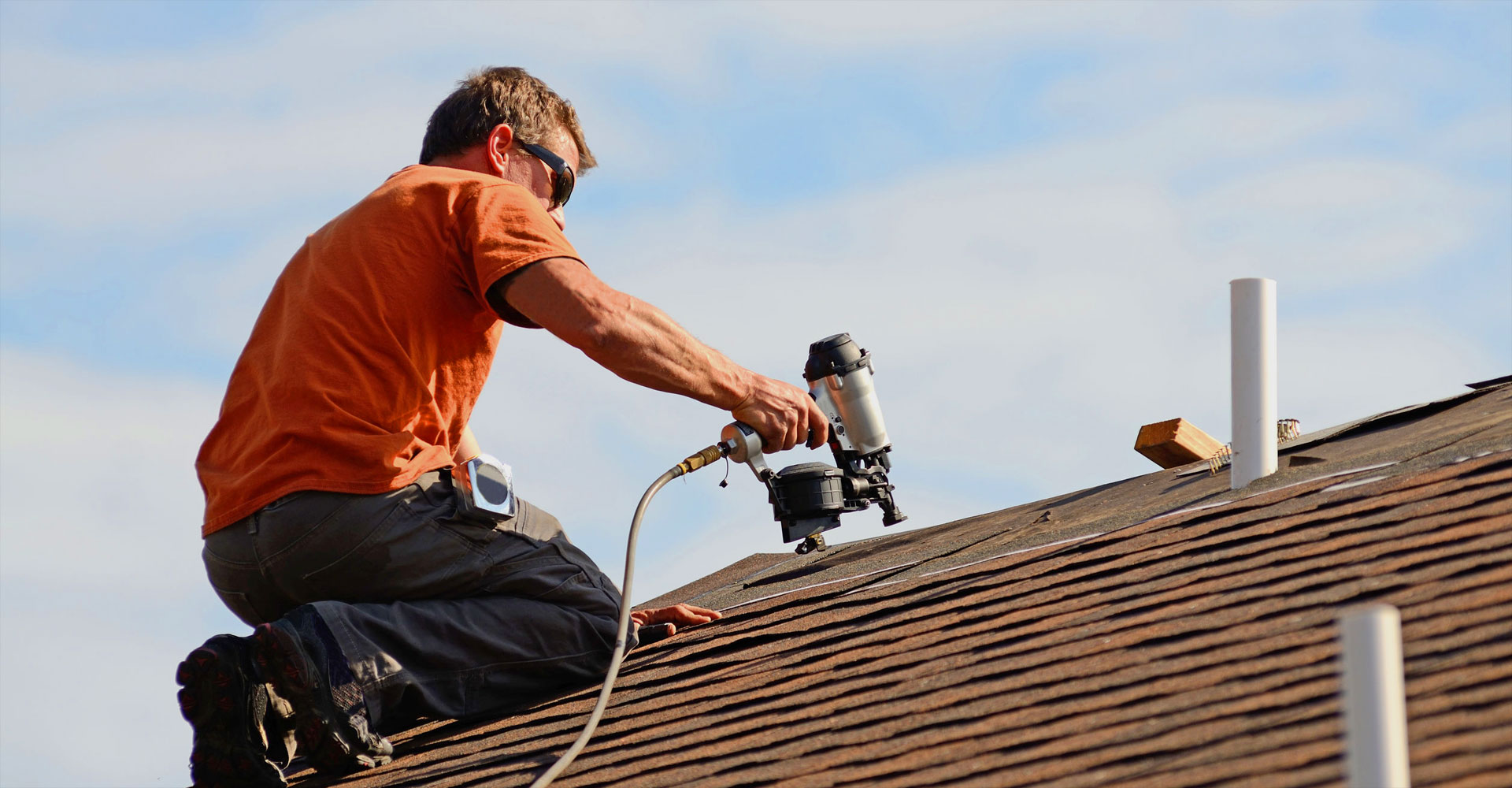 Roofer Installing Shingle Roof